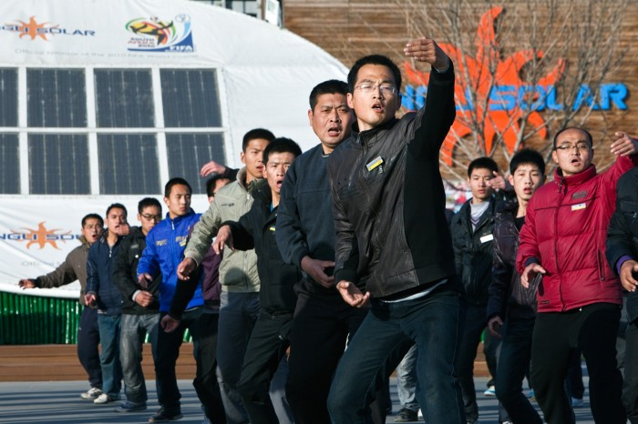 Yingli Solar module factory: workers exercising Kung-Fu/Baoding, China